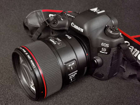 Canon 5D Mark IV camera with Canon EF 85mm f1.4 L IS USM lens on a black background. August 31, 2020. Warsaw, Poland