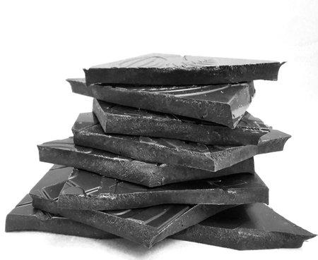 Closeup pieces of dark, inferior chocolate