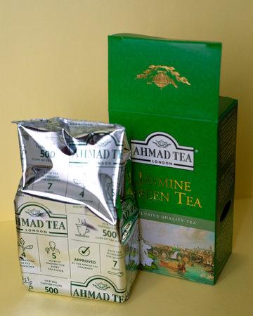 Ahmad tea. Jasmine green tea on a yellow background