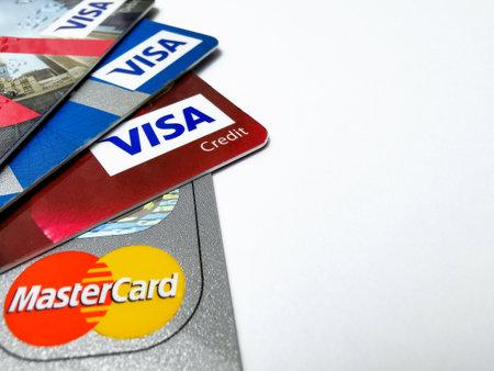 Choice of VISA and Mastercard credit cards. Closeup of VISA and Mastercard credit cards. 01/25/2021. Warsaw, Poland