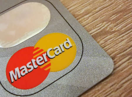 A macro closeup of a Mastercard credit card. Mastercard is one of the largest credit card companies in the world. 01/25/2021 Warsaw, Poland