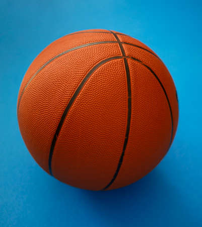 Closeup on basketball on a blue background
