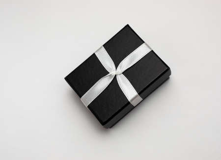 Small rectegular black gift box on a white background, top view