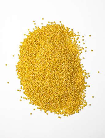 Raw millet groats on a white background