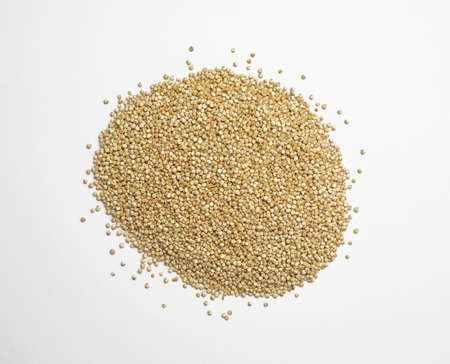 Raw quinoa seeds on a white background