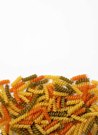 Tricolor, dry and raw pasta on a white background Banque d'images