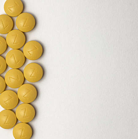 Iron in yellow tablets on a white background