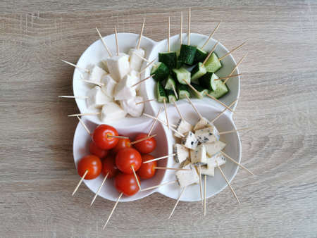 Cherry tomatoes, Cucumbers, Cheese Mocarella (Mozzarella) and Cheese with mold Banque d'images