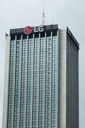 Logo of LG company on top of building in Warsaw. LG Corporation is South Korean multinational conglomerate corporation. Warsaw, Poland - April 6, 2021