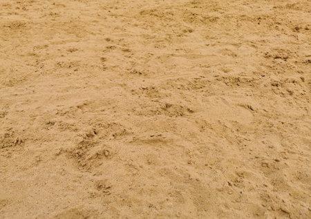 Closeup view of beach gold sand grain