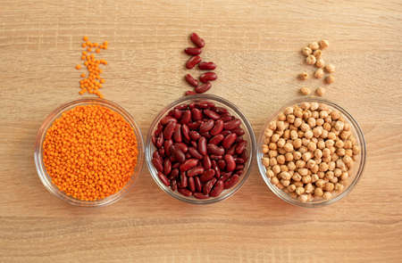 Bowls of cereal grains chickpeas, red lentils, red bean