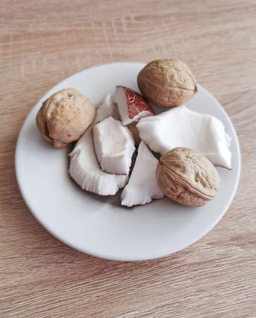 Nuts. Fresh coconut pieces and walnuts. Omega 3 and omega 6 fatty acids, healthy protein, vitamins and minerals Zdjęcie Seryjne