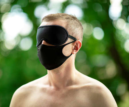 Lonely man during the virus pandemic. The mask becomes his everyday attribute. However, due to limitations in travel and interpersonal contacts, man becomes blind, surrounded by the beauty of nature