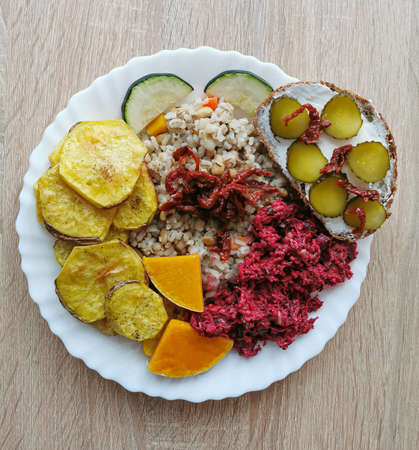 Pearl barley with soybeans, carrots, dried tomatoes. Baked potatoes, pumpkin and zucchini. Salad with beetroot and sandwich with dark bread