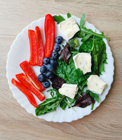 Fresh colorful breakfast with blueberries, green and red vegetables and cambazzola cheese Zdjęcie Seryjne