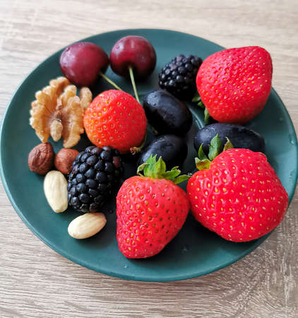 Fresh colorful berries and nuts are the best snack and dessert