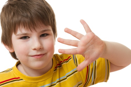 five fingers: Boy holds a hand with five fingers