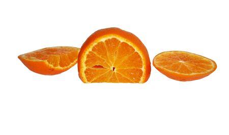 Parts of an orange orange. Orange on a white background. Sliced orange in different planes. Banco de Imagens