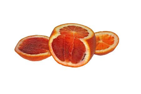 Parts of a red orange. Red orange on a white background. Sliced orange in different planes.