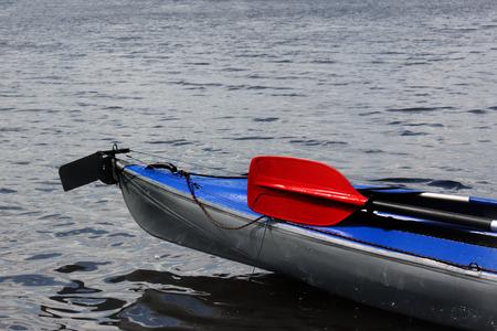 oar: Blue kayak and red oar  Stock Photo