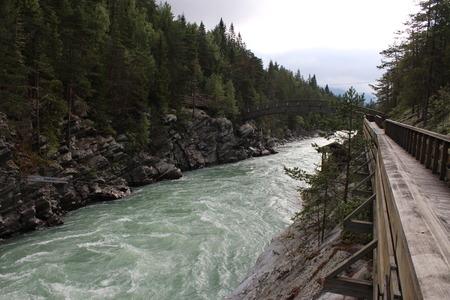 Wood bridge over the river. Near to Sjoa kayak camp. photo