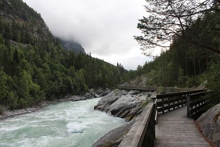 Sjoa kayak camp. Walking along the river. photo
