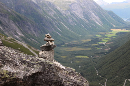 subjugation: The pile of stones is a sign of conquest the mountain.