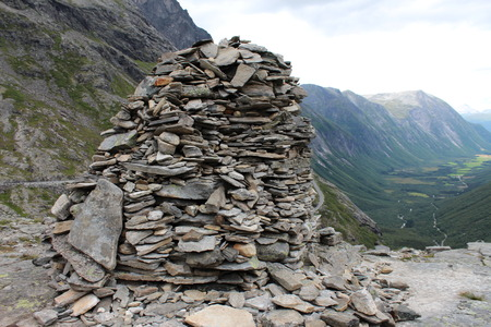 subjugation: The heap of stones is a sign of conquest the mountain.