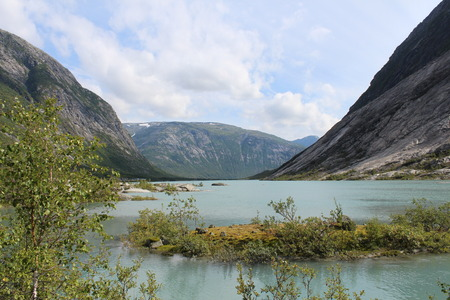 carex: Beautiful landscape of Norway. Mountains and lake. Stock Photo