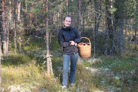 leningradskaya: Young woman with a basket of cepes mushrooms in the forest Stock Photo