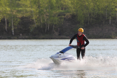 inclination: A man turn on the jet ski.