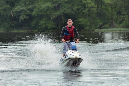 jet ski: Action Fotograf�a Hombre en jet ski. Foto de archivo