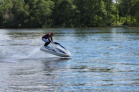 ski jump: Action Photo Man on jet ski. Jump. Stock Photo
