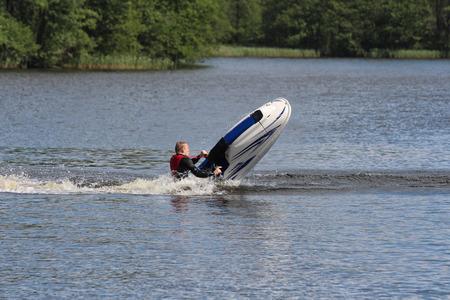 jet ski: A man is falling down from jet ski.