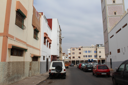 maroc: Arabian street with the parking cars on the road, Agadir, Morocco.