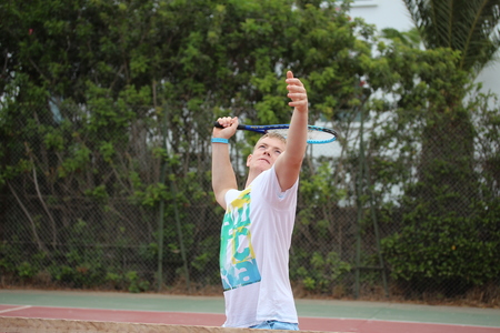 slavs: Young man playing tennis outdoor. Stock Photo