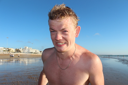 topless: Furious Screaming Man on the beach.
