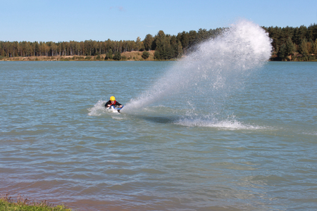 spurt: Guy put water spurt from the jet ski. Stock Photo