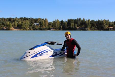 jet ski: Young man near his jet ski.