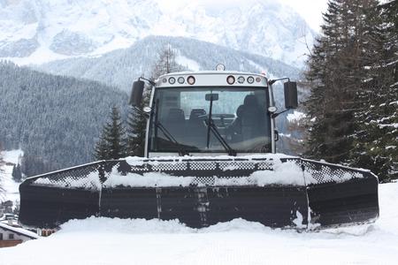 snowcat: Dolomites skiing resort. Snowcat. Snow remover equipment. Stock Photo