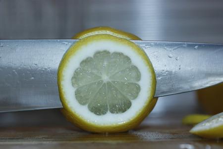 sappy: Cut a lemon with a knife.