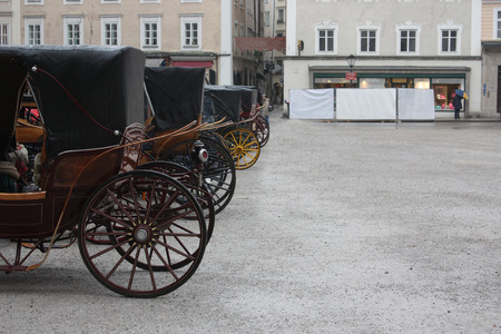 draught horse: Many carriages on the street. Stock Photo