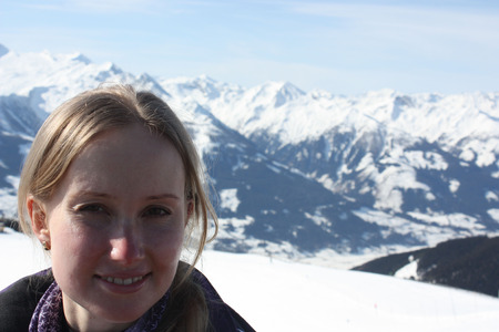 squint: Young beautiful woman face. Zell am See, skiing resort in Alps. Stock Photo