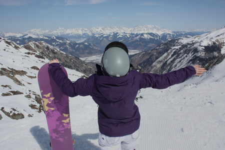 kaprun: Young woman on the Kaprun, skiing resort in Austria. A view from the back. Stock Photo