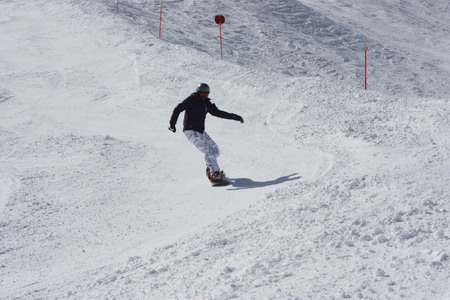 snowboarder: Young snowboarder woman sliding downhill. Stock Photo
