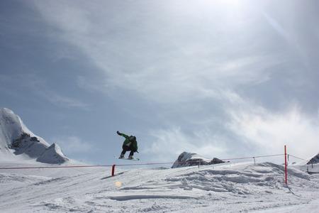 ski jump: Young snowboarder man doing ski jump.