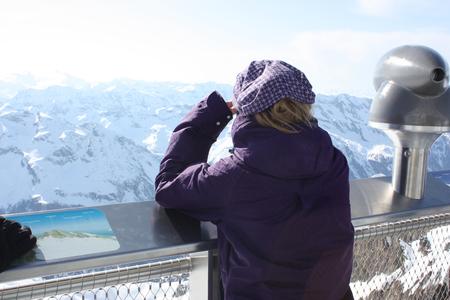 kaprun: Young woman from the back. Observation platform on the Kaprun, Austria.