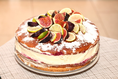 Tasty rustic biscuit cake with figs, lemons and limes slices.