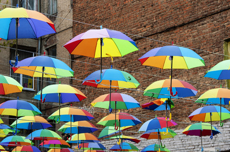 Umbrellas decorating the street. Happy multicolored sky. Festive umbrellas