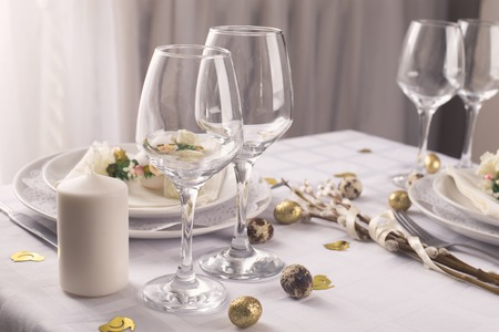 easter table setting in white and gold colors decorative elements